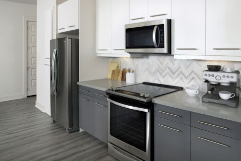 Kitchen with stainless steel appliances at Camden RiNo apartments in Denver, CO