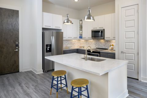 Kitchen with large island at Camden RiNo apartments in Denver, CO