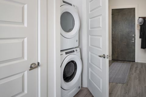 Laundry room at Camden RiNo apartments in Denver, CO