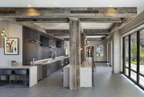 Resident lounge entertaining kitchen at Camden RiNo apartments in Denver, CO