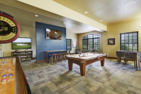 Gaming Lounge with Shuffleboard at Camden Riverwalk Apartments in Grapevine, TX