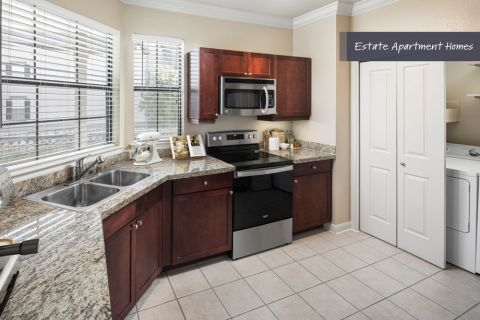 Estate Kitchen with stainless steel appliances at Camden Riverwalk Apartments in Grapevine, TX