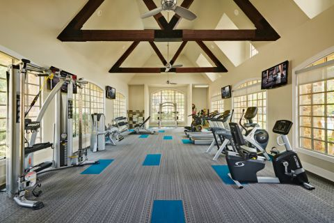 Fitness Center with cardio and strength training equipment + free weights at Camden Riverwalk Apartments in Grapevine, TX