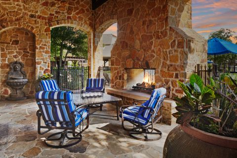 Outdoor Lounge with Fire Pit at Camden Riverwalk Apartments in Grapevine, TX