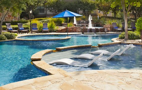 Resort-style Pool with Sundeck at Camden Riverwalk Apartments in Grapevine, TX