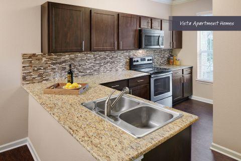 Modern Kitchen at Camden Riverwalk Apartments in Grapevine, TX