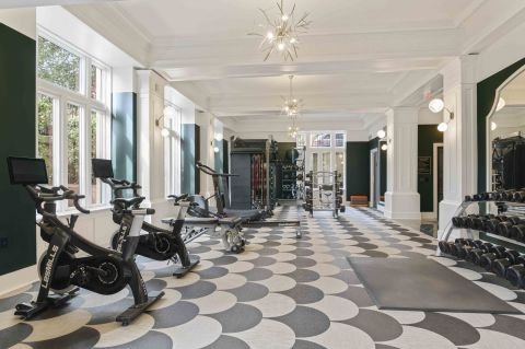 Camden Roosevelt Apartments Fitness Center with Lesmills Bikes and Row Machine in Washington, DC
