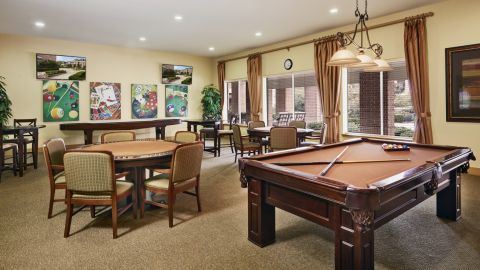 Game Room with Shuffleboard, Biilliards, and Poker Tables at Camden Royal Oaks Apartments in Houston, TX