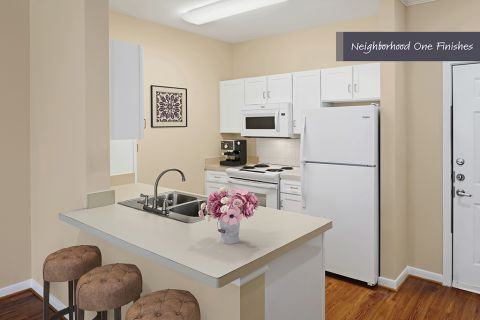 Kitchen with island seating at Camden Royal Oaks Apartments in Houston, TX