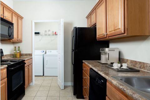 Kitchen and Washer Dryer at Camden Royal Palms Apartments in Brandon, FL