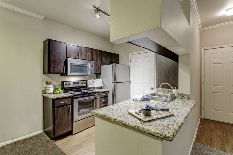 One bedroom kitchen with granite countertops at Camden San Marcos Apartments in Scottsdale, AZ