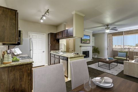 One bedroom living and dining room with fireplace at Camden San Marcos Apartments in Scottsdale, AZ