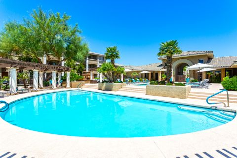 Pool with surrounding sundeck at Camden San Marcos Apartments in Scottsdale, AZ