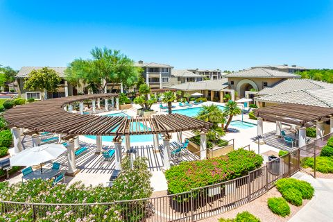 Aerial view of pool and outdoor lounge at Camden San Marcos Apartments in Scottsdale, AZ