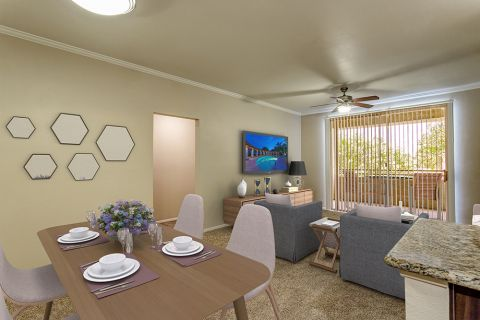 Open-concept dining and living area with private patio in two bedroom apartment at Camden San Marcos Apartments in Scottsdale, AZ