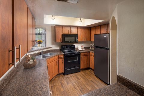 Kitchen with plenty of counter space at Camden San Paloma Apartments in Scottsdale, AZ