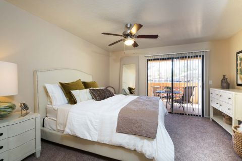Bedroom with Patio Access at Camden San Paloma Apartments in Scottsdale, AZ