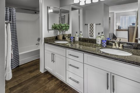 Double vanity sinks in bathroom at Camden Sea Palms Apartments in Costa Mesa, CA