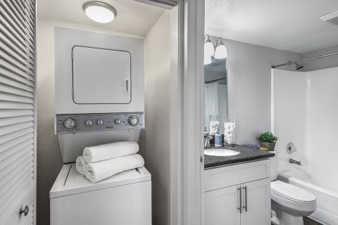 Stacked washer and dryer at Camden Sea Palms Apartments in Costa Mesa, CA