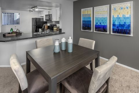 Open-concept kitchen and dining space at Camden Sea Palms Apartments in Costa Mesa, CA