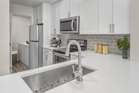 Renovated Kitchen and laundary room at Camden Sedgebrook Apartments in Huntersville, NC