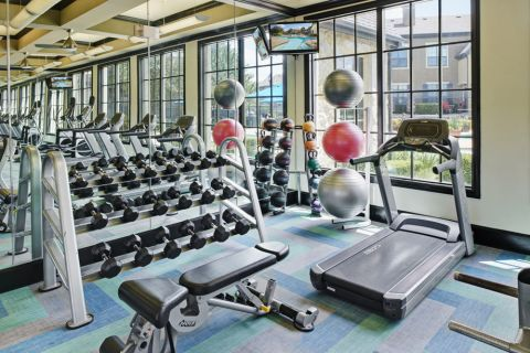 Fitness Center with cardio and free weights at Camden Shadow Brook apartments in Austin, TX
