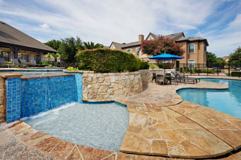 Swimming pool with water feature at Camden Shadow Brook apartments in Austin, TX