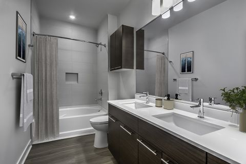 Bathroom with Quartz Countertops, Dual Vanity Sinks and Large Soaking Tub at Camden Shady Grove Apartments in Rockville, MD