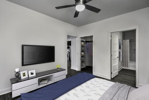 Bedroom with High Ceilings, Ceiling Fan, Walk-In Closet and Bathroom Attached at Camden Shady Grove Apartments in Rockville, MD