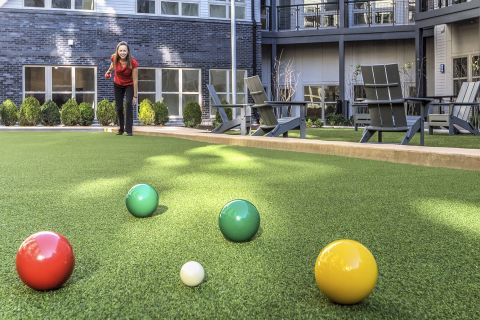 Outdoor Bocce Court and Courtyard with Lawn Games at Camden Shady Grove Apartments in Rockville, MD