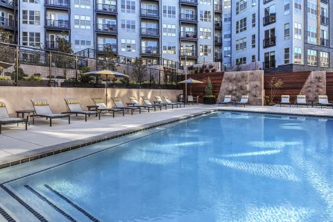 Swimming Pool with Lounge Chairs at Camden Shady Grove Apartments in Rockville, MD