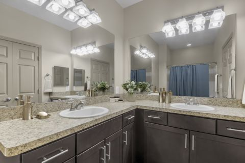 Double vanity bathroom at Camden Shiloh apartments in Kennesaw, GA