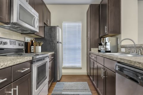 Kitchen with stainless steel appliances at Camden Shiloh apartments in Kennesaw, GA