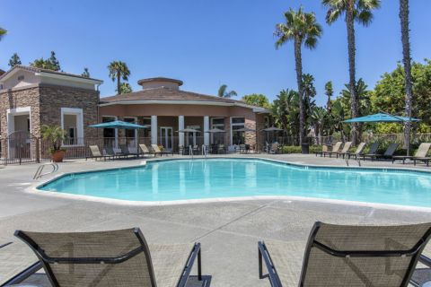 Swimming Pool with Chairs and Outdoor Dining Space at Camden Sierra at Otay Ranch Apartments in Chula Vista, CA