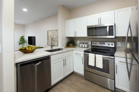 Kitchen with Stainless Steel Appliances at Camden Sierra at Otay Ranch Apartments in Chula Vista, CA