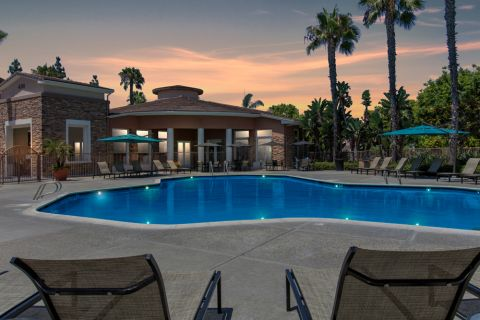 Dusk Swimming Pool with Chairs and Outdoor Dining Space at Camden Sierra at Otay Ranch Apartments in Chula Vista, CA