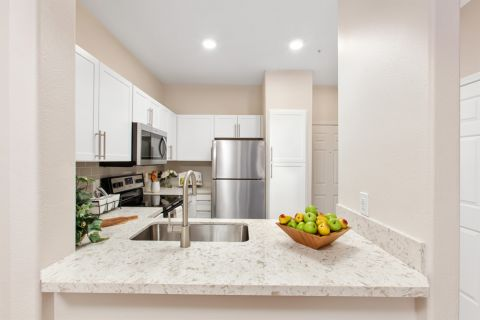 Kitchen with Breakfast Bar at Camden Sierra at Otay Ranch Apartments in Chula Vista, CA