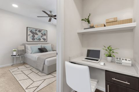 Bedroom with built-in desk at Camden Silo Creek Apartments in Ashburn, VA