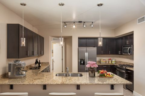 Penthouse Kitchen with Stainless Steel Appliances at Camden Sotelo Apartments in Tempe, Arizona