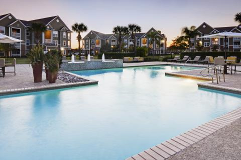 Resort-style Pool with Grills and Outdoor Lounge at Camden South Bay Apartments in Corpus Christi, TX