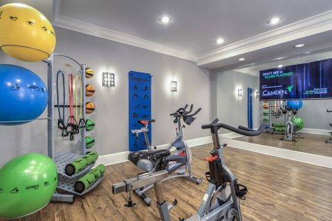 Yoga and Spin Studio with Balance Balls, Resistance Training Equipment and Large TV at Camden South End Apartments in Charlotte, NC