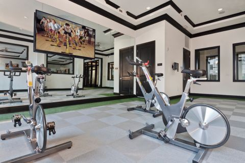 Fitness center with spin bikes at Camden Southline apartments in Charlotte, NC