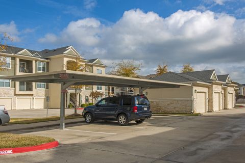 Covered Parking, Attached and Detached Garages Available at Camden Spring Creek Apartments in Spring and The Woodlands, TX