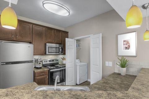 Kitchen and Laundry Room at Camden St. Clair Apartments in Atlanta, GA
