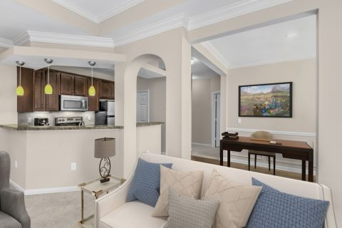 Living room and flex office space at Camden St. Clair Apartments in Atlanta, GA