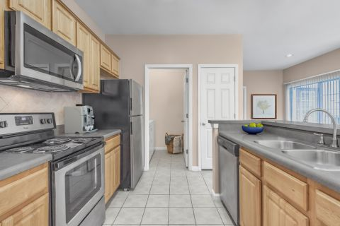 Kitchen and Laundry Room at Camden Stockbridge Apartments in Stockbridge, GA