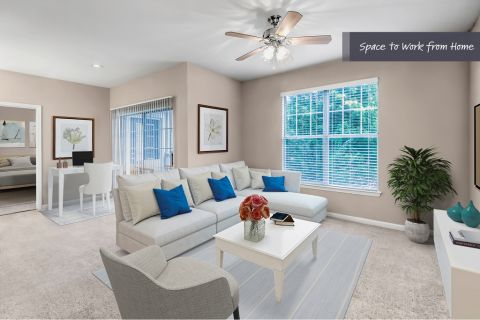 Living room with space to work from home at Camden Stockbridge Apartments in Stockbridge, GA