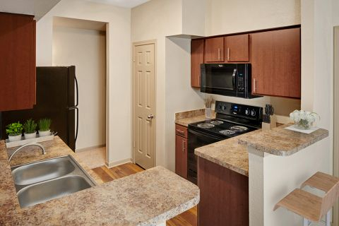 Walk-Through Kitchen at Camden Stonebridge Apartments in Houston, TX