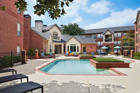 Swimming Pool with Lounge Chairs at Camden Stonebridge Apartments in Houston, TX