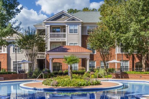 Resort-Style Pool with BBQs and Outdoor Dining at Camden Stonecrest Apartments in Charlotte, NC